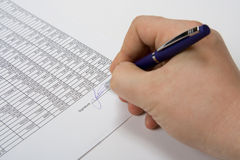 Hand signing the document. Royalty Free Stock Image