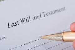 Hand signing last will and testament document Stock Photography