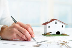 Hand signing real estate contract. Stock Photos