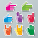 Hand signs. Colorful paper hand signs on light background Royalty Free Stock Photos