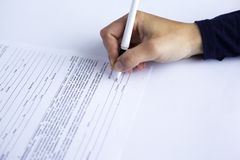 Hand signs a document blank,contract.signature model release stock photography