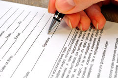 Hand signs the document Stock Photo