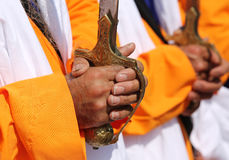 Hand of a sikh man on the hilt of the sword during the parade. Hand of a sikh man on the hilt of the sword Royalty Free Stock Photography