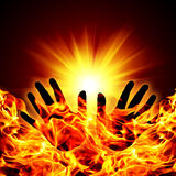 Hand silhouette. Against of fire and sun background Stock Images