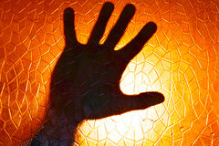 Hand Silhouette on Fire Orange Color Background Royalty Free Stock Photo