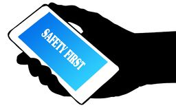 Hand silhouette holding phone with SAFETY FIRST text. Illustration concept Stock Photos