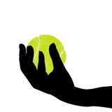 Hand silhouette holding a tennis ball Royalty Free Stock Images