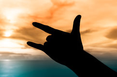 Hand silhouette under sunset Royalty Free Stock Photography