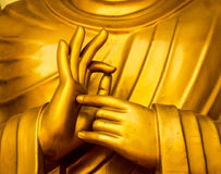 Buddha in the peace pagoda. The hand sing of a golden buddha statue in the peace pagoda in Pokhara , Nepal royalty free stock images