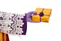 Hand of Sinterklaas showing gift. Isolated Royalty Free Stock Images