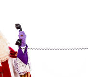 Hand of Sinterklaas with telephone Stock Images