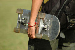 Hand with skateboard Royalty Free Stock Image
