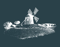 Hand sketch of rustic windmill in fields. Vector rural landscape illustration. Mediterranean countryside poster, card. Hand drawn sketch of rustic windmill in Stock Photos