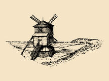 Hand sketch of rustic windmill in fields. Vector rural landscape illustration. Mediterranean countryside poster, card. Hand drawn sketch of rustic windmill in Royalty Free Stock Photos