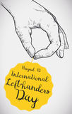 Hand in Sketch Style Gripping a Label for Left-Handers Day, Vector Illustration Stock Photos