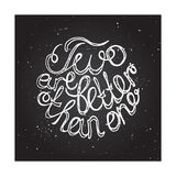 Hand-sketched typographic elements on chalkboard Royalty Free Stock Image