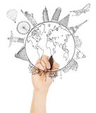 Hand sketching the Earth and Global map with landmark Royalty Free Stock Photos