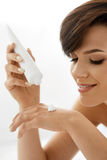 Hand Skin Care. Closeup Of Beautiful Woman Applying Cream Stock Image