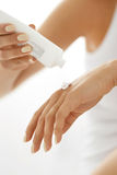 Hand Skin Care. Closeup Of Female Hands Holding Cream Tube Royalty Free Stock Photography