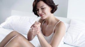 Hand Skin Care. Woman Applying Cream On Hands Skin
