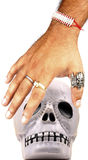 Hand and skull Stock Image