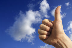 Hand in the sky. A hand saying ok against a blu sky royalty free stock photo