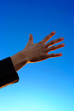 Hand On Sky Background Royalty Free Stock Photos