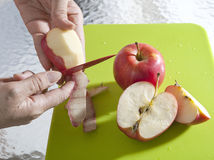 Hand sliced apples peel Royalty Free Stock Photo