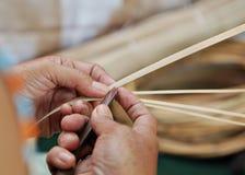 Hand slicling dried bamboo Royalty Free Stock Image