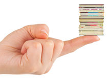 Hand and small books Royalty Free Stock Image
