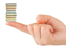 Hand and small books Stock Photos
