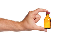 Hand with small bottle Royalty Free Stock Photos