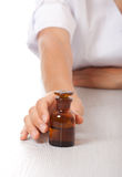 Hand with small bottle Royalty Free Stock Photography