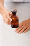 Hand with small bottle Stock Photography