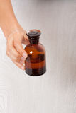 Hand with small bottle Royalty Free Stock Photo
