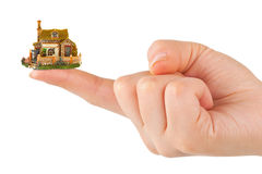 Hand and small house Stock Photos
