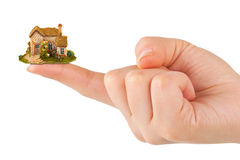 Hand and small house Royalty Free Stock Image