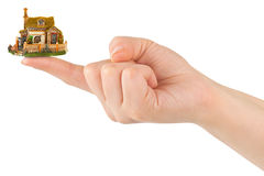 Hand and small house Royalty Free Stock Photos