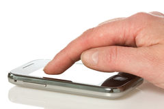 Hand with smart phone Stock Images