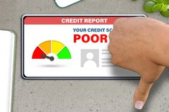 Hand with smart phone shows thumb down or dislike gesture   on stone table background - poor credit score technology concept. Poor credit score technology royalty free illustration