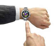 Hand with smart watch and finger touch screen Royalty Free Stock Image