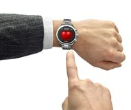 Hand with smart watch and finger touch screen Stock Photography