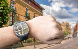 Hand with smart watch and GPS navigation system Stock Photography