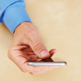 Hand with smartphone from above Stock Image