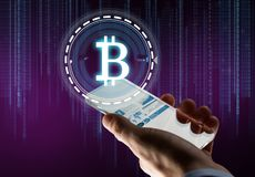 Hand with smartphone and bitcoin hologram. Business, cryptocurrency and future technology concept - close up of businessman hand with charts on transparent Stock Photography