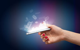Hand with smartphone and business icons Royalty Free Stock Photo
