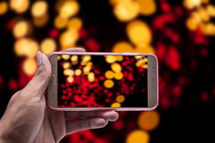 Hand with smartphone and light blurred, Clipping path Stock Photography