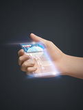 Hand and smartphone with news Royalty Free Stock Photo