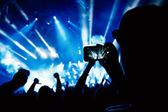 Hand with a smartphone records live music festival, Taking photo of concert stage Stock Photography