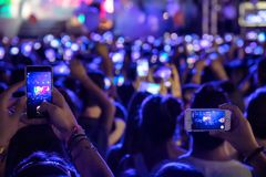 Hand with a smartphone records live music festival Royalty Free Stock Photos